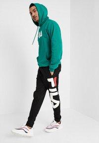 Fila - PURE BASIC PANTS - Verryttelyhousut - black - 1