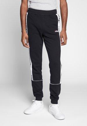 TEVIN - Spodnie treningowe - black/bright white