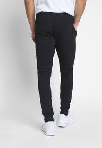 Fila - EDAN - Teplákové kalhoty - black - 2