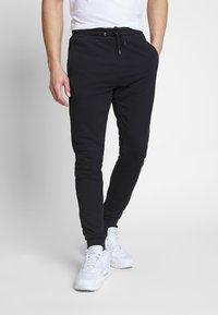 Fila - EDAN - Teplákové kalhoty - black - 0