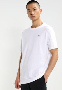 Fila - UNWINDE TEE - Basic T-shirt - bright white - 0