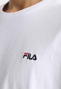 Fila - UNWINDE TEE - Basic T-shirt - bright white - 4
