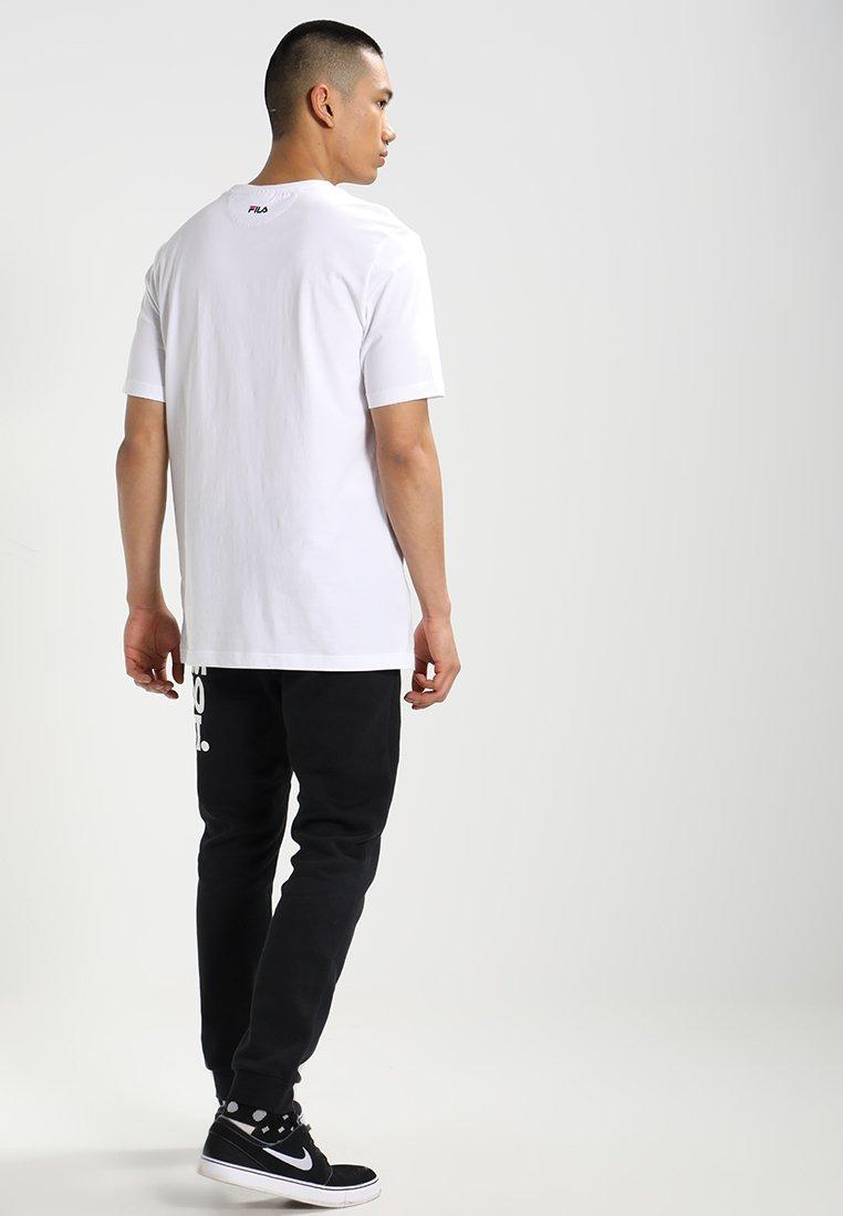 Fila UNWINDE TEE - Camiseta básica bright white