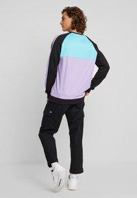 Fila - KAIL CREW - Sweatshirt - black/violet tulip/bright white/blue curacao - 2