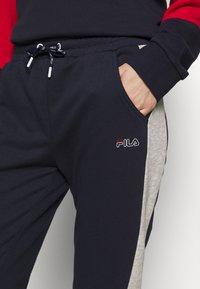 Fila - LAILA - Tracksuit bottoms - black iris/light grey melange - 4