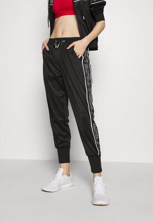 LIA - Tracksuit bottoms - black/bright white