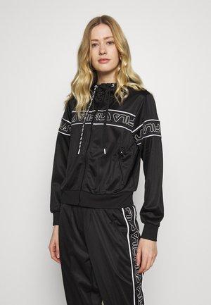 LIA - Training jacket - black/bright white