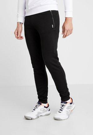KIRK - Teplákové kalhoty - black