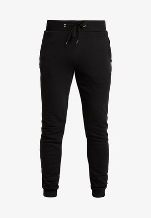 KIRK - Tracksuit bottoms - black