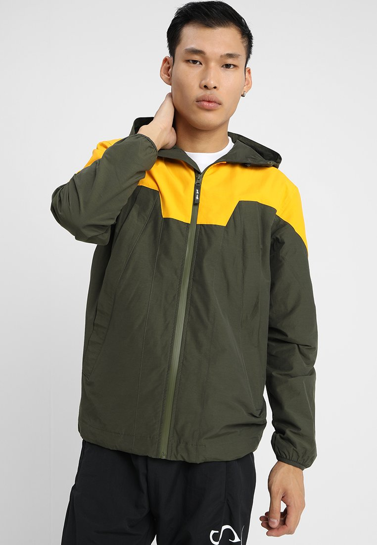 Gio Goi - PANELLED WITH HEAT SEAL ZIPS - Summer jacket - forest