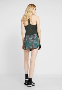 Lotto - SUPERRAPIDA SKIRT - Sports skirt - green resin - 2