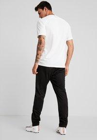 Lotto - DELTA PANT - Pantalon de survêtement - all black - 2