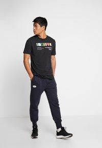 Lotto - DELTA PANT  - Pantalon de survêtement - navy blue - 1