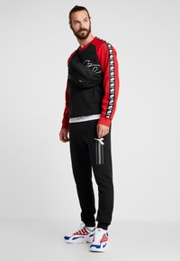 Lotto - ATHLETICA - Sweatshirt - all black/flame red - 1