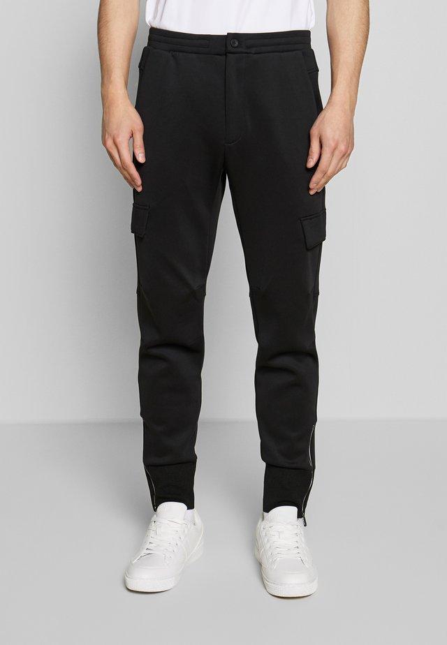 KORSXTECH ARTICULATED JOGGER - Pantalones deportivos - black