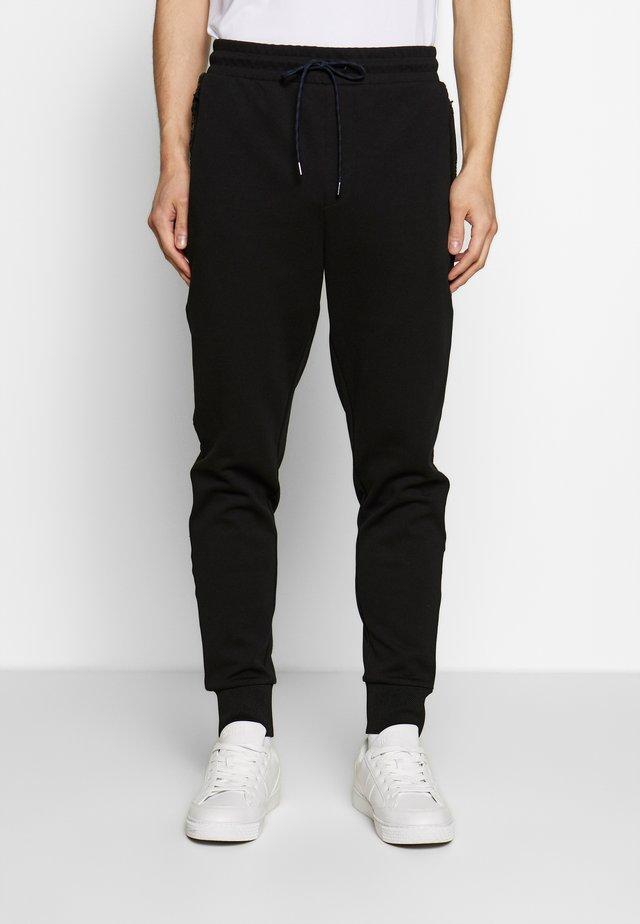 XTECH LOGO JOGGER - Pantalones deportivos - black
