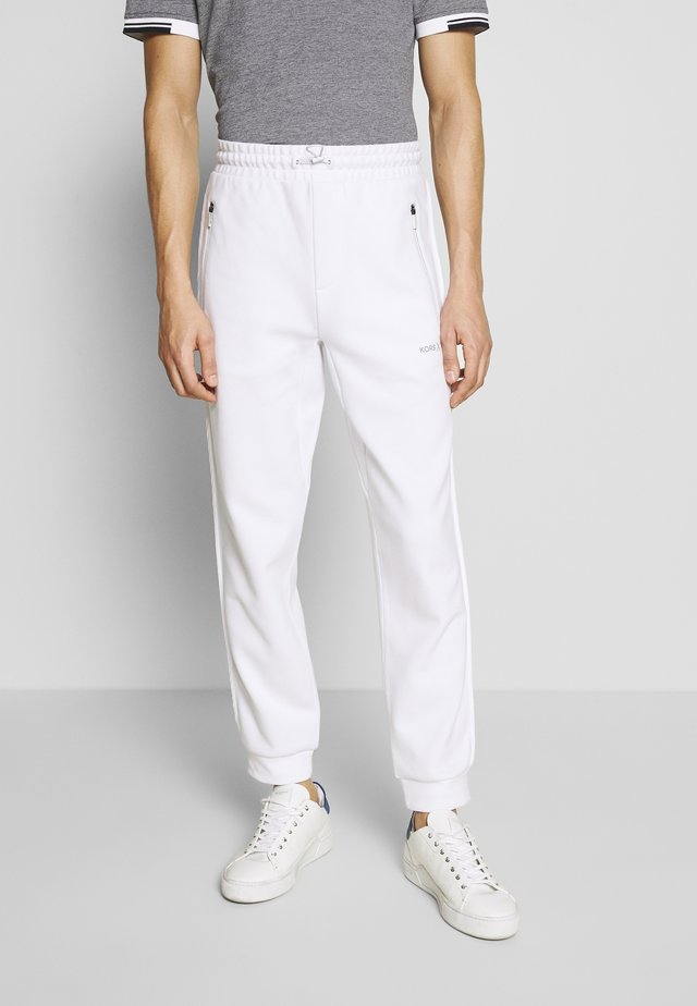 BINDED JOGGER - Träningsbyxor - white