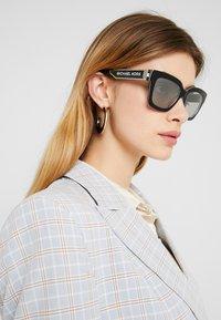 Michael Kors - Sunglasses - black sport laminate - 1