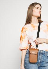 Michael Kors - GREYSON FLAP PHONE XBODY - Across body bag - cognac - 4