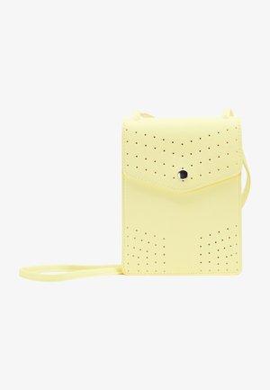 Skuldertasker - light yellow