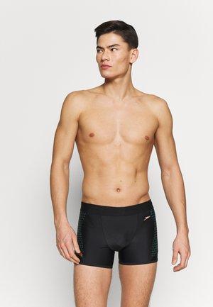 PANEL - Swimming trunks - black/green glow