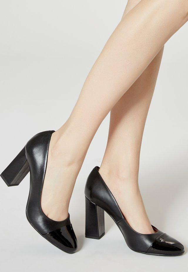 High heels - schwarz lack