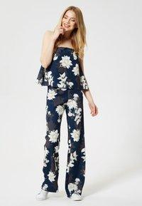 Usha - Tuta jumpsuit - dark blue/beige - 0
