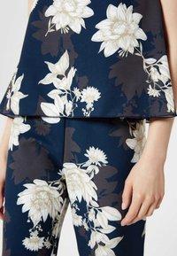Usha - Tuta jumpsuit - dark blue/beige - 4