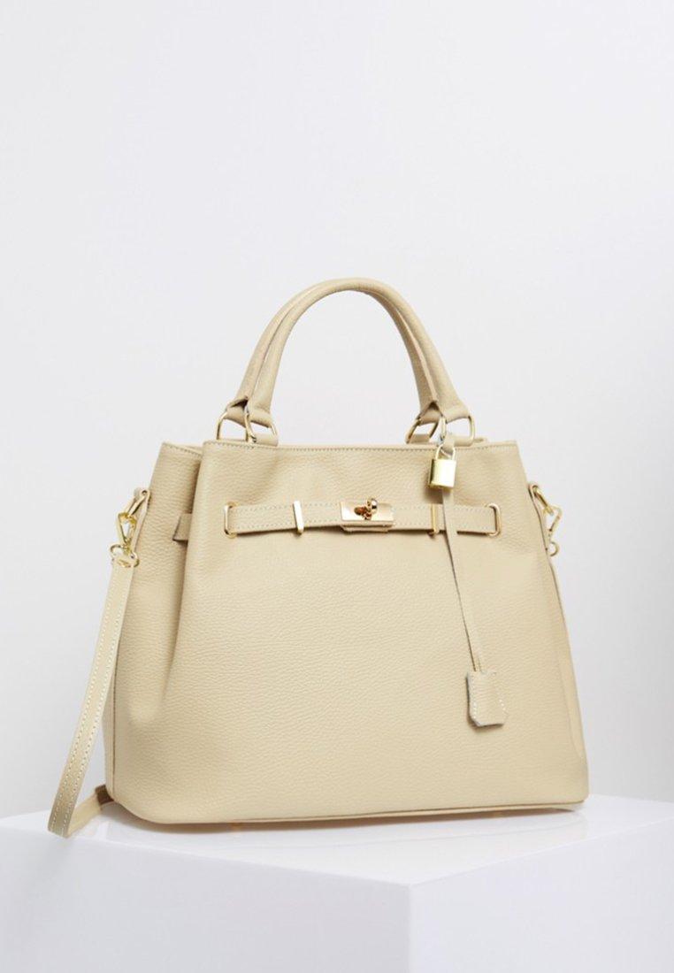 Usha - Handväska - beige