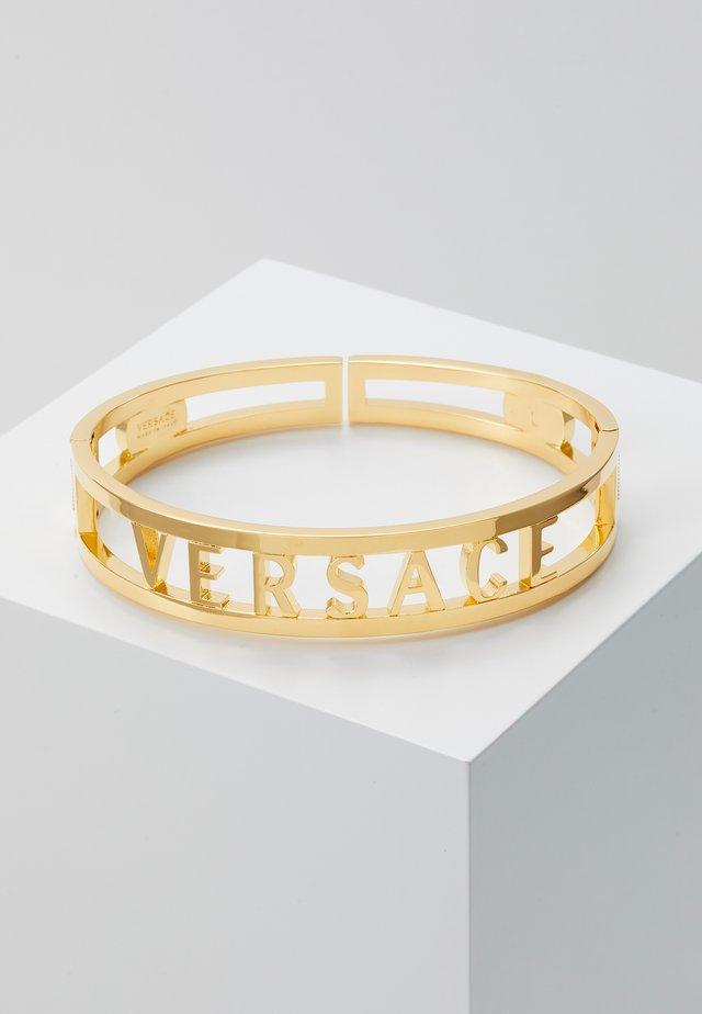 Bracelet - oro caldo