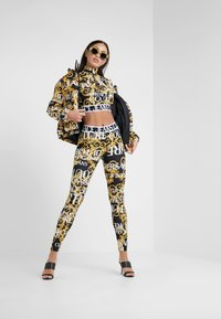 Versace Jeans Couture - Leggings - Trousers - nero