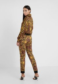 Versace Jeans Couture - Tracksuit bottoms - gold - 2