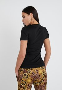 Versace Jeans Couture - T-shirt con stampa - nero - 2