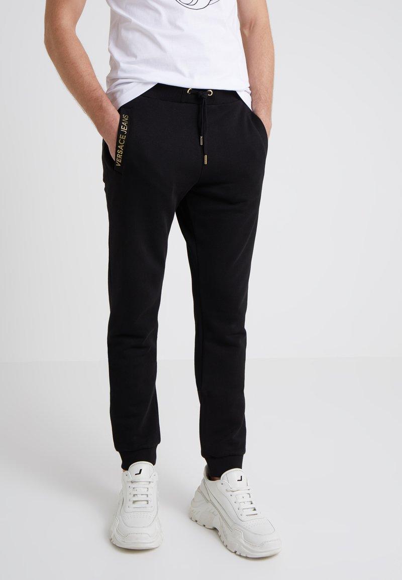 Versace Jeans - JOGGERS - Træningsbukser - black