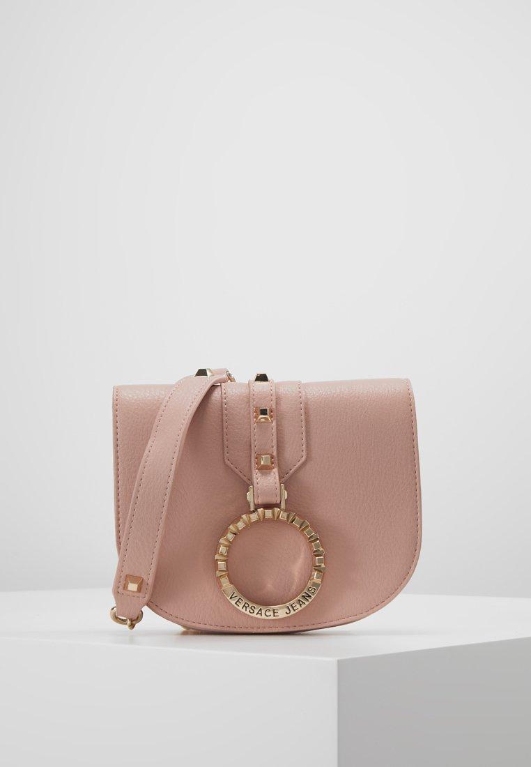 Versace Jeans - ROUND FLAP DOME CROSSBODY - Across body bag - rosa