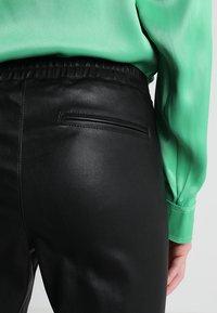 Ibana - HEARTY - Pantalón de cuero - black - 6
