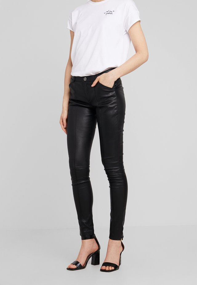 ELIZA - Leather trousers - black