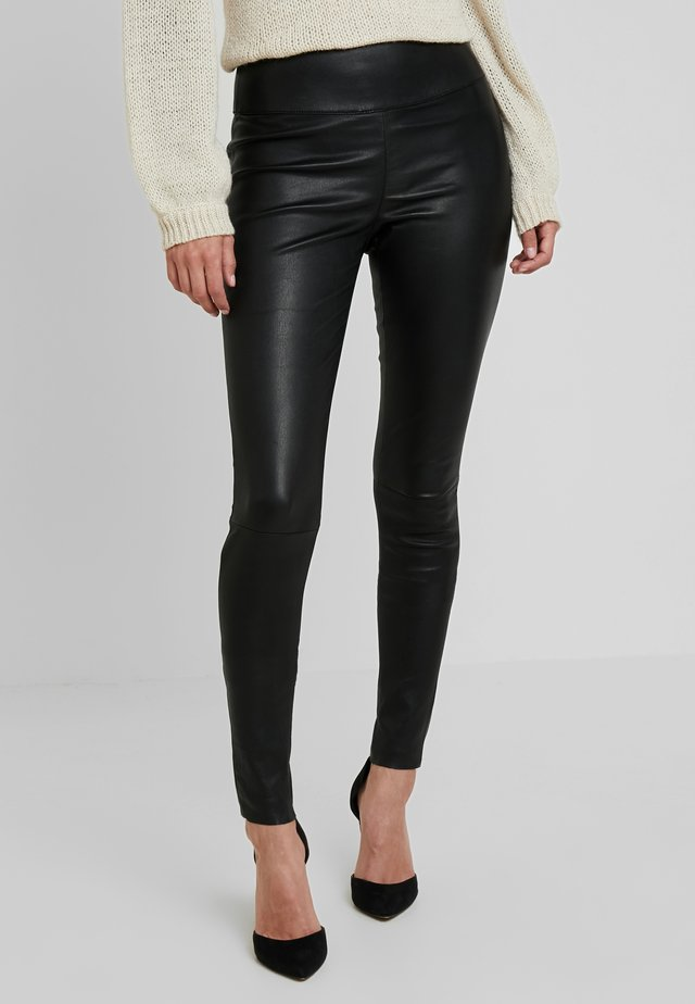 MOLLY - Leather trousers - black