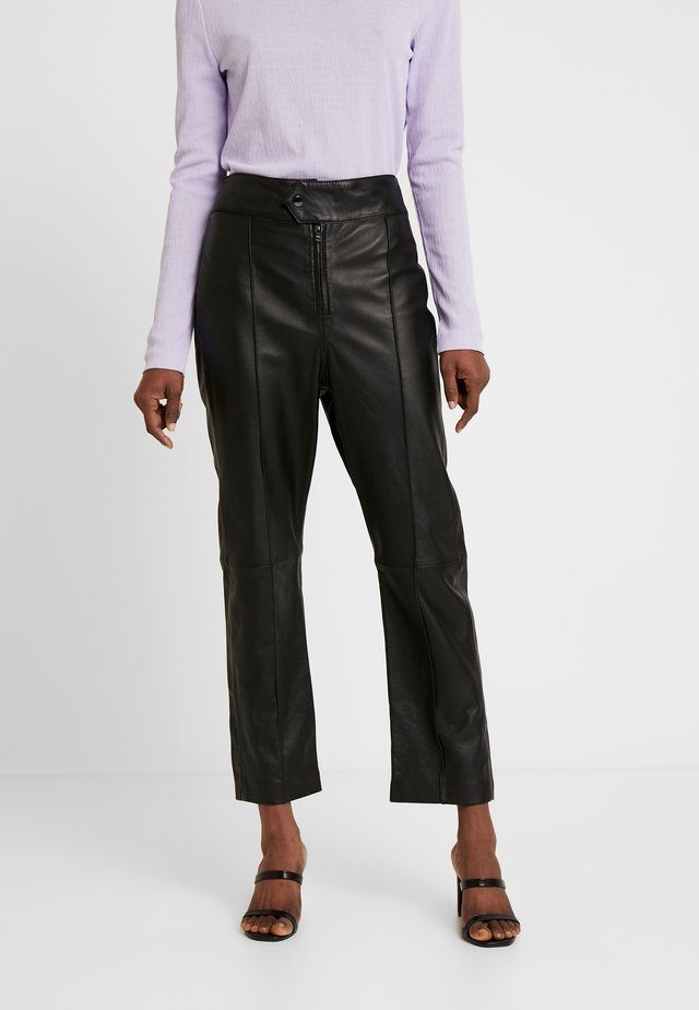 BARBRA - Leather trousers - black