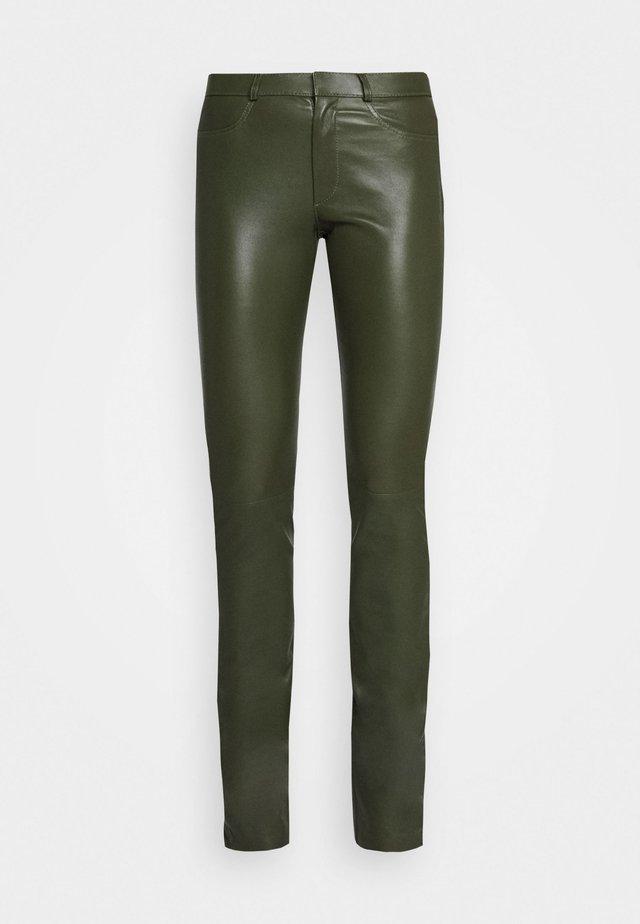 LUCILLE - Skinnbyxor - green
