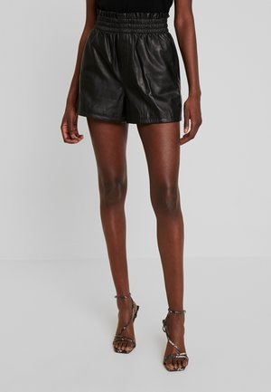 FEAST - Leather trousers - black