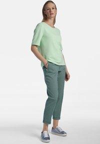 Basler - MIT REISSVERSCHLUSS - Print T-shirt - mint - 1
