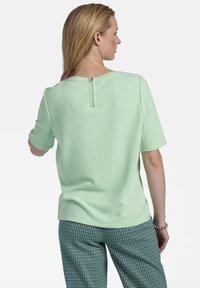 Basler - MIT REISSVERSCHLUSS - Print T-shirt - mint - 2