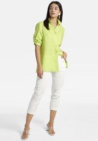 Basler - MIT BRUSTTASCHE UND KNOPFLEISTE - Button-down blouse - light green - 1