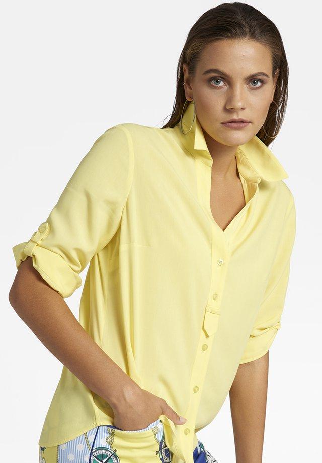 MIT KNOPFLEISTE  - Button-down blouse - gelb