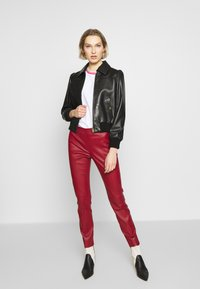 Bally - TROUSERS - Leggings - Trousers - bally red - 1
