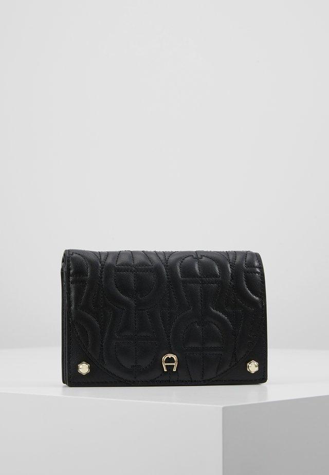 DIADORA QUILTED FLAPOVER - Wallet - black