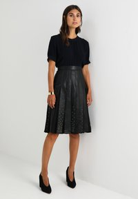 MARCIANO LOS ANGELES - MALVINA PLEATED SKIRT - A-line skirt - jet black - 1