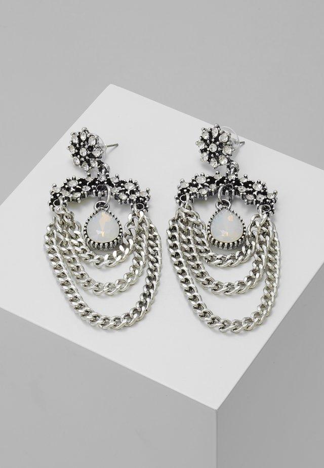 Kolczyki - silver-coloured