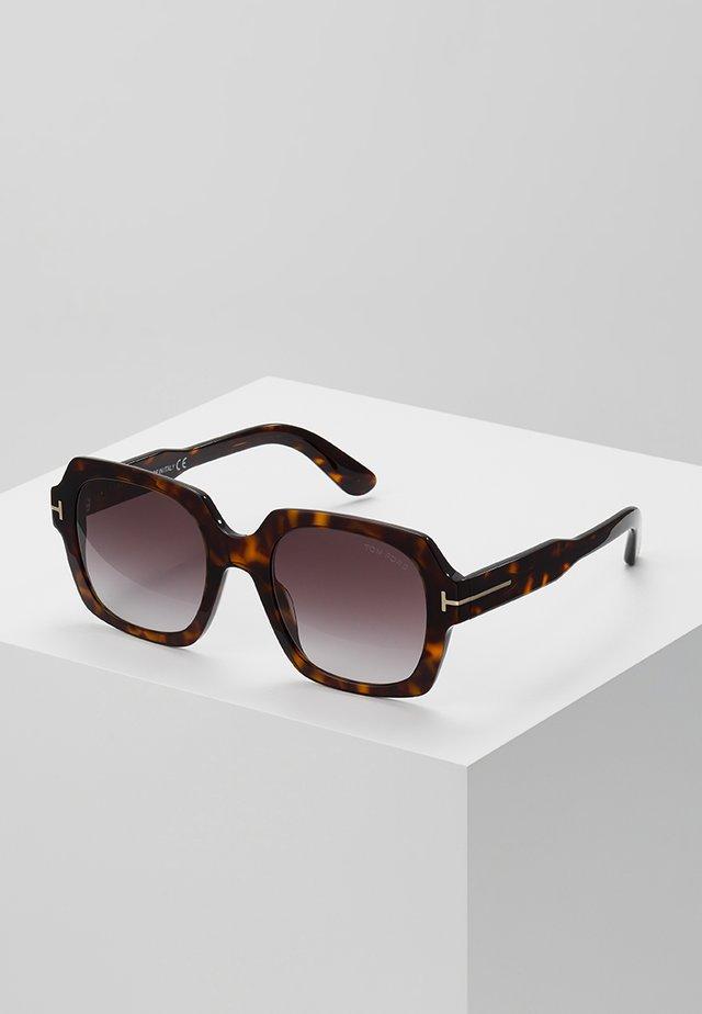 Aurinkolasit - mottled brown